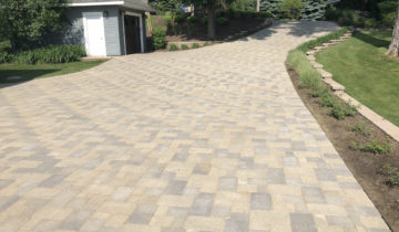 Brick Paver Driveway Repair, Cleaning, Polymeric Sand & Sealing Transforms A Neglected Driveway In Rochester Hills Michigan
